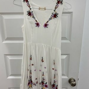White dress with floral accents